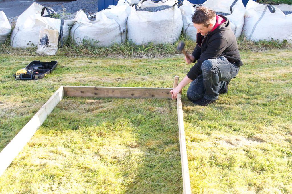 Ciaran hammering in a post - Teacher Training Workshop, Castlebar, Co. Mayo, Ireland